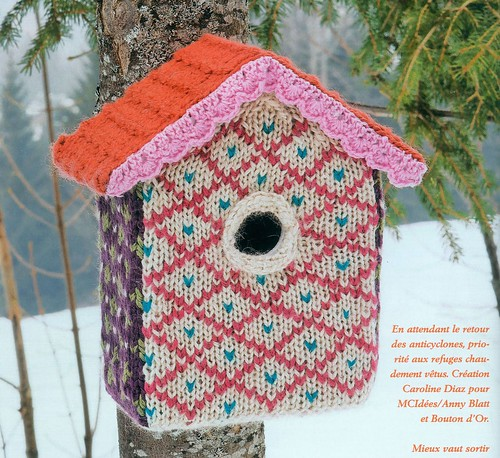 birdhouse covered in knit and edged in crochet