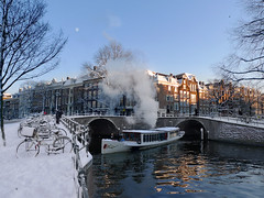 Winter Magic canal cruise in Amsterdam (Bn) Tags: cruise winter moon snow holland netherlands amsterdam fairytale topf50 tour seagull 19thcentury bridges bikes bluesky steam picturesque topf100 slippery touristattraction steamengine nostalgie herengracht canalboat stoom maan reguliersgracht canalhouses veniceofthenorth partyboat stoomboot schoonheid latesunlight 100faves 50faves wintertimes cityofbikes amsterdamsegrachten dewolk dutchcanalhouses salonboat classicpostcard romanticwinter 18december2010 wintermagiccanalcruiseinamsterdam packagehouses stoommachineuitde19eeeuw winterwonderlijkamsterdam stoomfluiten oudetijdenherleven readyforawhitechristmas wintryimage shiplikenoother pleasantcruise classicimageofamsterdam attractionofholland klassiekeopname fabricageesscherwyssengine nostalgischewinteropname