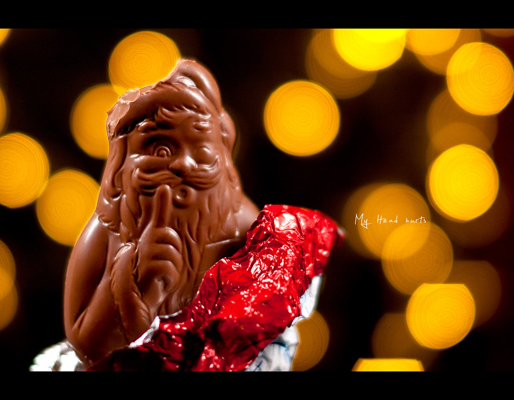 Day 142, 142/365, Project 365, Bokeh, Strobist, Santa, Headache, head hurts, Santa has a headache, warpping paper, chocolate, milka, shiny, bokeh bubbles, ssshhhhh, ourdailychallenge, What catches your Eye, sb-80dx, project365, 50mm, Sigma 50mm F1.4 EX