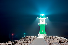 Leading the way home (etomsen) Tags: ocean winter light sea lighthouse colour nature architecture tom germany deutschland lowlight warnemnde meer europa europe natur architektur beacon farbe hdr highdynamicrange rostock available leuchtturm mv hansestadt brd langzeitbelichtung mecklenburgvorpommern leuchtfeuer longtimeexposure lightfire engelhardt ozean starbord steuerbord meckpom tamron175028