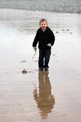 Portrait (denise..) Tags: boy sea cold beach sand digging pebbles reflextion dilan