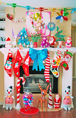 Christmas Mantle (boopsie.daisy) Tags: santa christmas winter decorations red holiday snow color cute ice home colors stockings vintage reindeer living cupcakes rainbow snowman fireplace colorful december interior stripes room cream kitsch doe garland deer wreath cupcake fawn ornaments inflatable cameras bow snowmen bulbs bumble candycane wonderland decor 2010 especiallyforkristinstaceandmenna