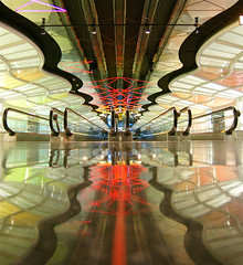 Neon Tunnel (Greg Adams Photography) Tags: travel winter lines reflections lights neon united tunnel terminal walkway transit passage ord ual eyecandy unitedairlines terminal1 2011 michaelhayden skysthelimit neonsculpture hhsc2000 gershwintunnel californiaartistmichaelhayden