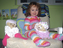 toddler in pajamas with two teddybears sporting underwear hats and shirts...