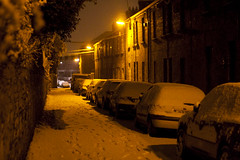 Snow-Covered Dublin #8 ([m.w]) Tags: road street trees ireland houses light dublin white house snow cold tree cars lamp car yellow stone wall night dark print lights streetlight streetlamp streetlamps streetlights victorian footprints vehicles vehicle prints lamps snowfall canoneos350d footprint glasnevin canonef50mmf18ii