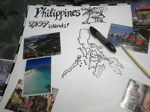 Drawing The Philippine Map With Black Marker.
