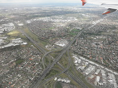 One Of Melbourne's Interchanges (thienzieyung) Tags: city houses plane buildings flying airport view suburban aviation transport australia melbourne places victoria off aerial take highways fields suburbs geography roads freeways interchange brimbank mooneevalley thienzieyung