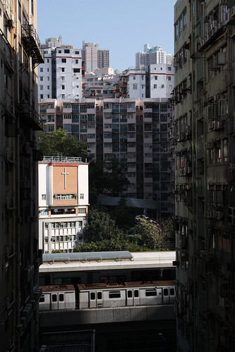 Looking between buildings at the elevated Kwun Tong station