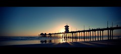 huntington beach (Eric 5D Mark III) Tags: california light sunset shadow sky people cloud seascape color landscape pier walk surfer orangecounty huntingtonbeach tone cnaon horizontalpanorama sunbrusts ef1635mmf28liiusm eos5dmarkii hpano