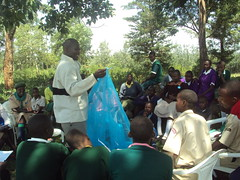 Scouts from Taranganya Mixed Primary School in Kuria West, Nyanza are shown how to handle mosquito nets (DFID - UK Department for International Development) Tags: education kenya health scouts prevention disease malaria supershot infectiousdiseases departmentforinternationaldevelopment dfid bednets overseasaid ukaid