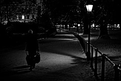 On a Winter's Night a Traveler (Chris JL) Tags: uk winter blackandwhite bw snow london window hat night iso3200 lights photo shadows path streetphotography luggage lamppost greenpark traveler pitchblack nikkor35mmf14g nikond3s chrisjl onawintersnightatraveler