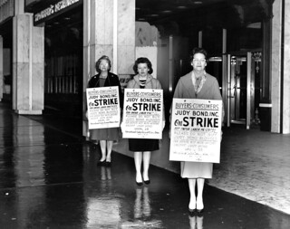 Three women hold signs at the Merchandise Mart in Atlanta, Georgia, urging people not to buy Judy Bond blouses, March 1, 1962.