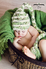 Sleepy Elf (Kidzmom2009) Tags: sleeping baby green basket innocent knithat woodfloor handonface wovenbasket elfhat babyinabasket kidzmom2009 familygetty2010 kfsphotography