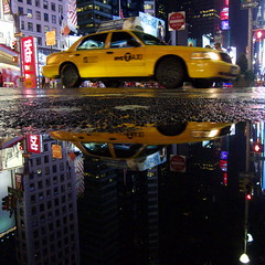 Taxi Cab in Times Square (Airicsson) Tags: street new york city nyc summer urban usa ny reflection rain island lumix us walk manhattan cab taxi panasonic rainy 2010 streetshot lx3