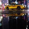 Taxi Cab in Times Square (Airicsson) Tags: street new york city nyc summer urban usa ny reflection rain island lumix us walk manhattan cab taxi panasonic rainy 2010 streetshot lx3