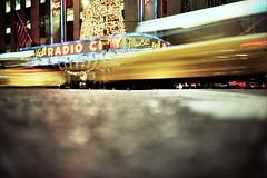 Life moves pretty fast. (the brownhorse) Tags: road christmas usa newyork blur america us lomo xpro taxi christmastree lomolca crossprocessing slowshutter radiocity shutterspeed ratseyeview wwwadambronkhorstcom 20081129lomolca0012