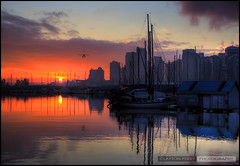 Sunrise Over Vancouver (Clayton Perry Photoworks) Tags: winter skyline vancouver plane sunrise reflections boats hdr coalharbour