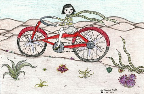 """Snake Scarf"" by Catherine Eyde, a drawing in which a girl wearing a long-sleeved shirt, a skirt and kneesocks rides through cacti-dotted hills of sand on a giant red bicycle with a green, two-headed snake wrapped around her neck like a scarf"