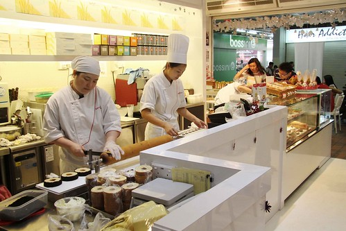 Chefs making Baumkuchen