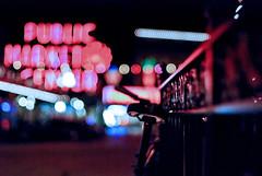 Public Market...HFF! (ewitsoe) Tags: hff happyfencefriday fences fenced fench bokeh wa seattle d80 50mm dof art light autumn fall nikon washington market bike bicycle downtown urban pov seattlepublicmarket pikeplacemarket vintagefeel withverylittlelightleftafterworktryingmyhandatabitofnightshooting