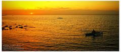 Sun sets for another day (Bong Tabelon III) Tags: sunset orange yellow landscape boat fishing nikon rocks warm philippines cebu tones d90 minglanilla cebusugbo