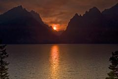 Sunset at Jenny Lake (bhophotos) Tags: travel sunset red orange usa lake mountains nature water colors yellow clouds landscape geotagged nikon cloudy smoke wyoming tetons grandtetonnationalpark jennylake cascadecanyon d700 2470mmf28g jacksonholevalley projectweather