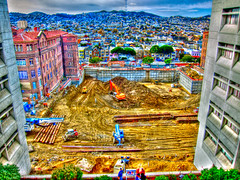 General Hospital Construction Zone Handheld HDR (Walker Dukes) Tags: sanfrancisco california street wood old blue windows red sky urban orange white tractor black brick green tower art glass yellow clouds photoshop truck canon buildings reflections landscape cityscape crane hill cement tracks logs foundation vehicles dirt photographs photograph sutro blocks backhoe wispy piles grungy hardhats photomatix tonemapping canons95