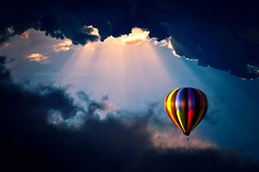 """Hope is like the sun, which, as we journey toward it, casts the shadow of our burden behind us"" (Violet Kashi) Tags: sky sun colors clouds photography nikon ps explore hotairballoon rays frontpage lightroom צילום hss d90 cs5 sliderssunday"