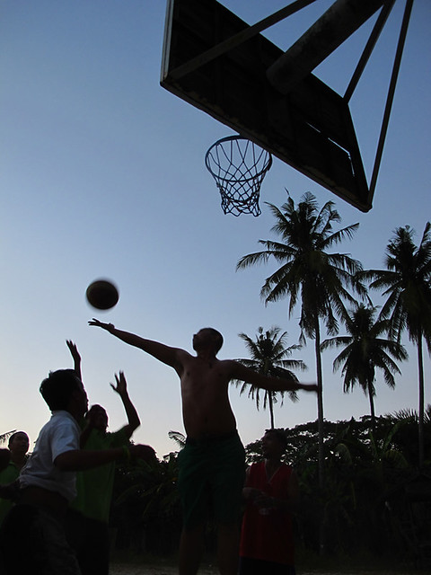 adarna boys basketball game at dusk
