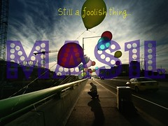 MAS1L's First Album Cover (il0venirvana) Tags: city bridge blue red summer sky urban man colour green slr 120 mamiya film car yellow architecture clouds buildings mediumformat balloons paul prime evening vanishingpoint 645 fuji photographer crane taxi perspective australia melbourne wideangle victoria scan bin negative string epson docklands railing kneeling 6x45 cloudporn picnik reala goldenhour mamiya645 bloke urbanlandscape lowsun populated longshadows c41 spaceframe latrobest v700 humanfigure cloudage mamiya645protl conder m645 port1010 docklandsstadium gsub vermininc fujicolorsuperiareala100 35mmf35sekorn etihadstadium
