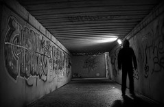 silent night (i k o) Tags: blackandwhite bw man canon dark underpass underground subway eos graffiti darkness ombra surreal tunnel spray bn uomo vignetting notte hdr scribble bogeyman biancoenero buio 18mm shadowman progetto shadowproject sottopassaggio scarabocchi vignettatura 450d tenebra uomoombra theauthorsplaza theauthorsclub