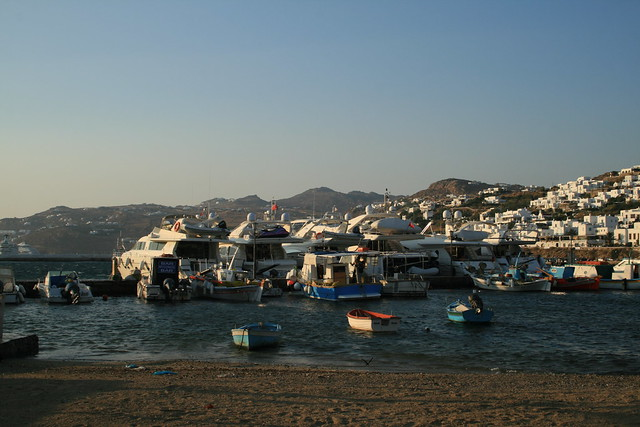 boats and white houses at sunset