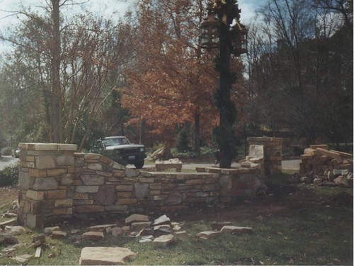 newly finshied center stone wall connecting two stone columns in Raleigh, Norht Carolina
