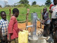 A girl in Kitumu uses the new pump
