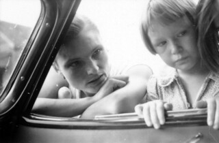 Woman and child looking into a car window