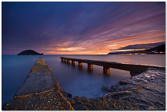ligurian blue hour (chris frick) Tags: longexposure sea seascape coast jetty tripod wideangle filter shore lee gitzo mediterraneansea ballhead alassio albenga isolagallinara canonef1635mmf28liiusm chrisfrick 09nd canoneso5dmark2 075gndhard