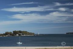 Grand Marais 7681 (niphoto) Tags: america anchor coastguard grandmarais greatlakes harbor lakesuperior lighthouse michigan moored sailboat sailing tranquil unitedstates upperpeninsula lake travel