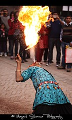 Fire Mouth !! [EXPLORE] Dec 7 2010 (Mayank Sharma renewed :D :D) Tags: carnival blue red people india man black public yellow festival canon mouth fire delhi culture clothes celebration tradition rajasthan artiste canon50mm firemouth