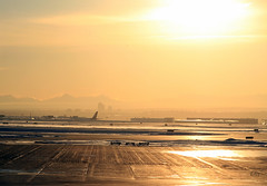Snowy Airfield, Distant City & Mountains in the Evening Sun (zeesstof) Tags: snow canada mountains calgary rockies airport eveningsun alberta airliner airfield intothesun canon7d canon18135is zeesstof distantcalgary hopeiwontfrythesensor