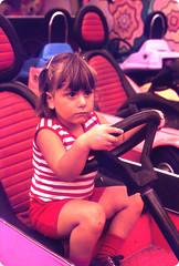 Genine, Adventureland (Mario Genna) Tags: summer steering daughter longisland amusementpark 1978 bumpercars agfachrome64