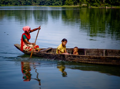 An Independant Mother With her children (Megher_desher_meye) Tags: sun black nature water girl river lights boat women colours child ttl bangladesh rangamati canon500d nimmy kaptai naturewatcher kaptailake