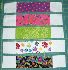 Sew Background rectangles to each side of each strip
