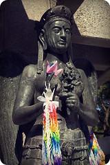 statue at the base of the tower (natsukigirl) Tags: japan honeymoon peace hiroshima  worldpeace peacepark  peacememorialpark peacememorial