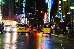 Taxi Cab Rushing in Theatre District (Airicsson) Tags: street new york city nyc summer urban usa ny reflection rain island lumix us walk manhattan cab taxi panasonic rainy timessquare 2010 streetshot theatredistrict lx3