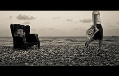 (ssj_george) Tags: sea sky people bw white man black beach monochrome sepia clouds paper walking lens lumix boat newspaper sand holding chair raw ship arm horizon cream cyprus file pebbles sneakers panasonic pancake 20mm armchair plage tone dmc larnaca boarders f17 gf1 oroklini creamtone voroklini  georgestavrinos  ssjgeorge
