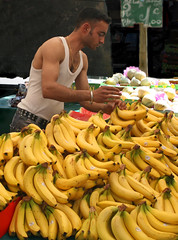 Banana man (R. O. Flinn) Tags: man paris france fruit market bananas vendor salesman