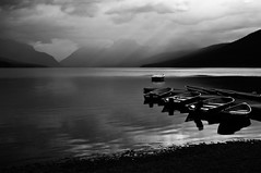 Lake McDonald (Glacier National Park), Apgar (flatworldsedge) Tags: park cloud white lake black boats montana ray jetty glacier national sunbeam mcdonald apgar explored yahoo:yourpictures=blackandwhite yahoo:yourpictures=landscape