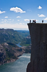 Base Jumping at Preikestolen (Jim Boud) Tags: ocean sky cliff mountain norway clouds digital canon eos rebel hike atlantic adventure fjord basejumping hdr cliffjumping xsi preikestolen prekestolen lysefjorden norse pulpitrock 450d forsand jimboud hybridhdr exposurefusion jrbxom jamesboud