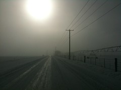 Foggy, Snowy Road  Kittitas County, Washington (Steve G. Bisig) Tags: cameraphone road winter sun snow apple mobile fog rural fence wires poles irrigation iphone