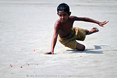 The game... (mostakim timur) Tags: life playing game sports canon eos sand kiss war 85mm player gamer luck warrior aim dhaka usm marble dust f18 bangladesh ef timur skill x3 500d canonef85mmf18usm maoa mostakim t1i canoneoskissx3 mostakimtimur mdmoazzemmostakim moazzem